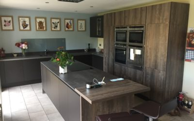 CONTEMPORARY GRAPHITE AND OAK KITCHEN WITH ISLAND AND BAR TOP
